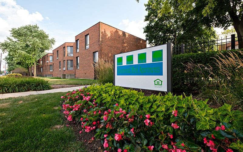 Greenwood Park Apartments sign and flowers