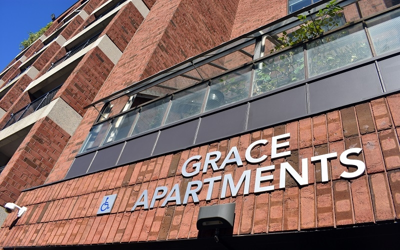 Grace Apartments close up of sign