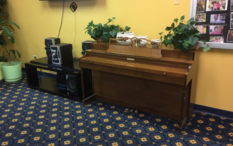 Martin Farrell House activity room with piano