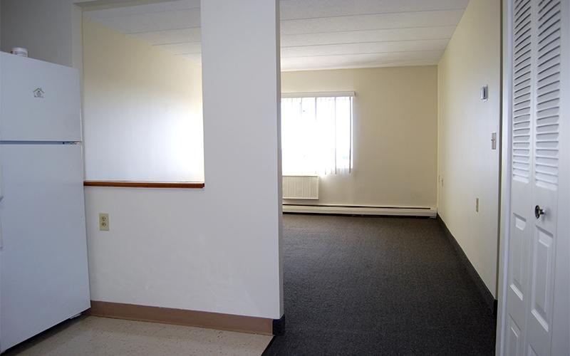 Pocasset Manor living room and kitchen