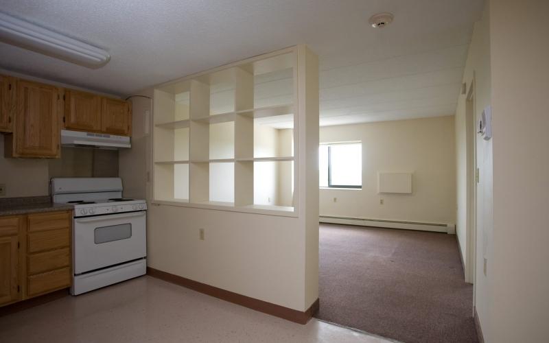 Hillcrest Village unit kitchen and living room