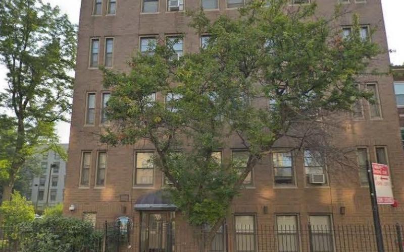 Corcoran Place Apartments brick exterior & trees
