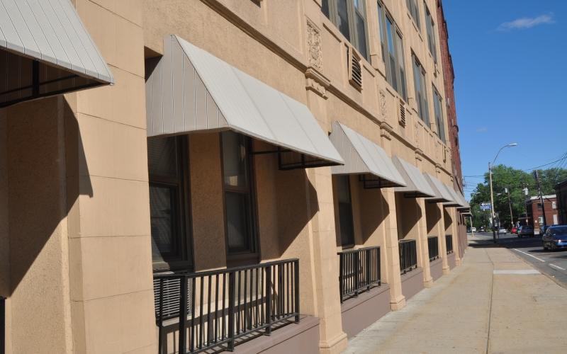 Tribune Apartments exterior and sidewalk